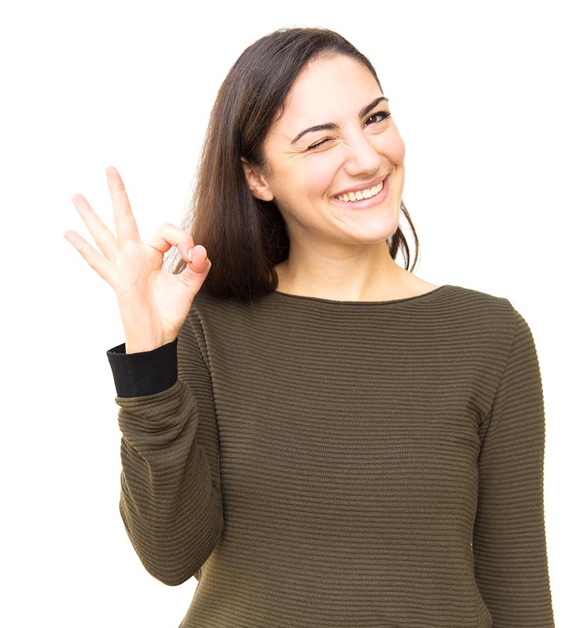 Happy positive beautiful woman making Okay hand gesture